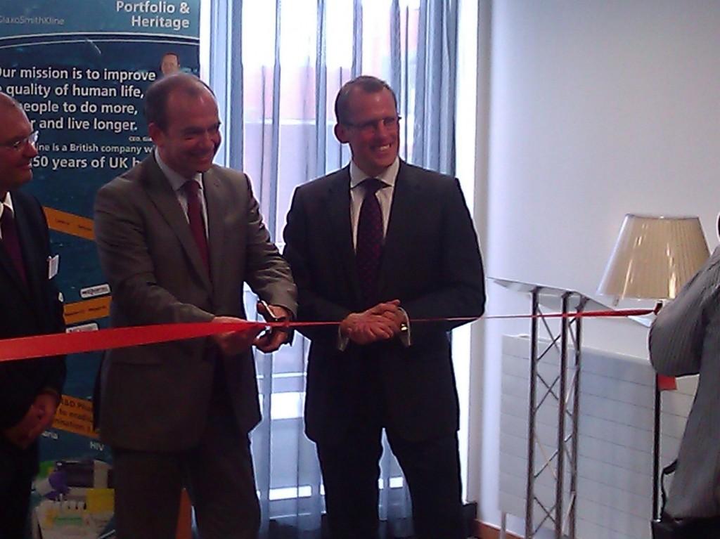 Dr McBride cuts the ribbon at the new GSK NI office.