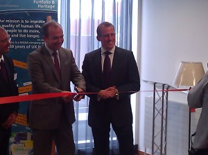 Dr McBride cuts the ribbon at the new GSK NI office.
